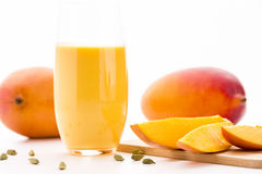 Cut Mango Pieces, Cardamon And Fruit Shake Stock Photos