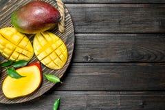 Cut mango on a tray royalty free stock photos