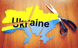Cut map of Ukraine. Concept of disintegration the country. Cut map of Ukraine. Concept of disintegration of the country Royalty Free Stock Images
