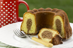 Cut marble cake. In the garden Royalty Free Stock Photography