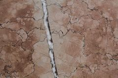 A slab of marble slab with bright white mica and many veins royalty free stock photo