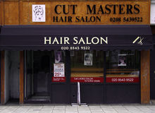 Cut Masters hair salon. Hair salon in a street of London city. UK Royalty Free Stock Images