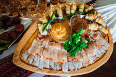 Cut meat lies on the original wooden dishes Royalty Free Stock Images