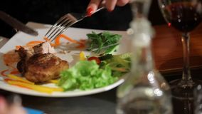 Cut the meat on a plate. In cafe stock video footage