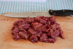 Cut meat. Raw meat cut into chunks Stock Photos