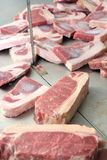 Cut of meats in butcher Stock Images