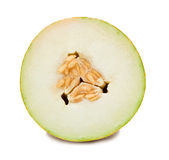 Cut melon. Closeup of cut ripe melon. Isolated on white Stock Photography