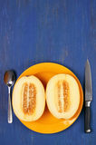 Cut melon on blue wood Stock Images