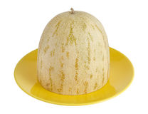 The cut melon lies on a dish.  royalty free stock image