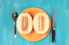 Cut melon on turquoise wood Stock Images