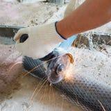 Cut metal mesh circular saw. Close-up, bright sparks Royalty Free Stock Photo