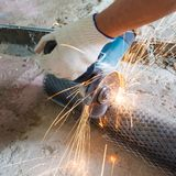 Cut metal mesh circular saw Stock Photos
