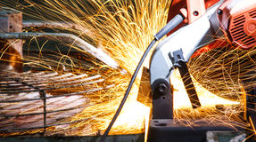 Cut metal. Worker cut metal with electric saw then it spark Royalty Free Stock Photo