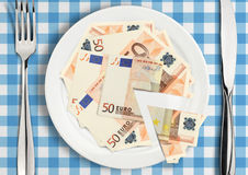 Cut money on plate, finance tax concept royalty free stock photography