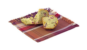 Cut muffin on napkin Stock Images