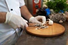 Cut mushrooms on board Stock Image