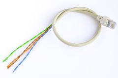 Cut network cable. The cut network cable of type rj-45 Royalty Free Stock Photography