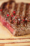 Cut off Beef steak on a wooden board and table Stock Images