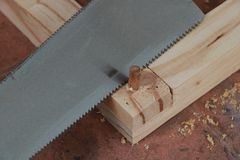 Cut off the excess dowel Royalty Free Stock Images