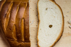 Cut off a piece of loaf bread Royalty Free Stock Photos