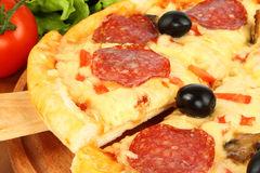 Cut off slice pizza Stock Photography