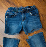 Cut old jeans. On wooden boards Stock Image