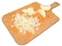 Cut onion on a chopping board Stock Image