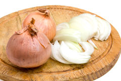 Cut onion on chopping board Stock Images