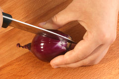 Cut onion to make vegetable soup Stock Photos