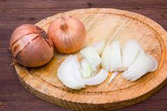 Cut onion on wood Stock Photography