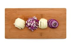 Cut onion on wooden board Stock Photography