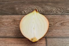 Cut onion on wooden floor royalty free stock image