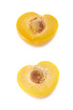 Cut open plum half isolated Royalty Free Stock Images