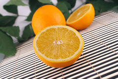 The cut orange on a bamboo napkin Royalty Free Stock Photography