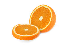 Cut orange fruits isolated on white. Background Royalty Free Stock Photos