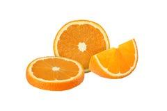 Cut orange fruits isolated on white background Royalty Free Stock Images