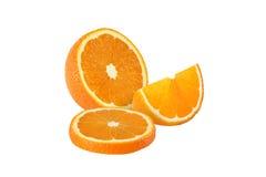 Cut orange fruits isolated on white background Royalty Free Stock Photos