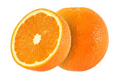 Cut orange fruits  on white. Background Royalty Free Stock Image