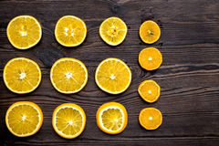 Cut orange fruits on wooden background top view mock up Royalty Free Stock Photo