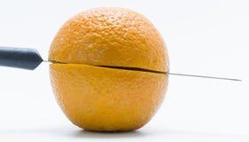 Cut orange. Orange has been cut by knife Royalty Free Stock Image