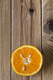 Cut Orange Overhead on Wood Stock Images