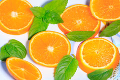 Cut orange on a plate Stock Images