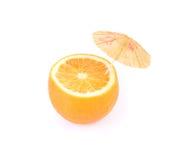 Cut orange under umbrella. Royalty Free Stock Photos