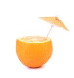 Cut orange under umbrella Royalty Free Stock Images