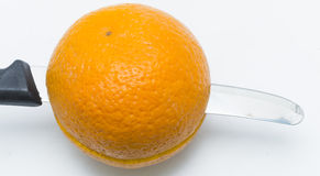 Cut orange. Orange was cut by knife Royalty Free Stock Image