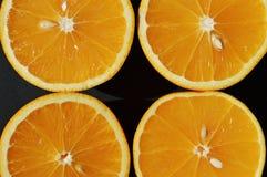 Cut oranges on black background Stock Image