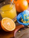 Cut oranges. Pressed orange manual method. Oranges and sliced oranges with juice and squeezer. Royalty Free Stock Photo