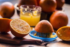 Cut oranges. Pressed orange manual method. Oranges and sliced oranges with juice and squeezer. Royalty Free Stock Image
