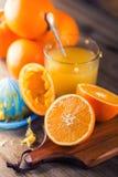 Cut oranges. Pressed orange manual method. Oranges and sliced oranges with juice and squeezer. Royalty Free Stock Image