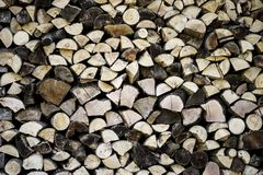 Cut and ordered logs of wood, frontally photographed Stock Image